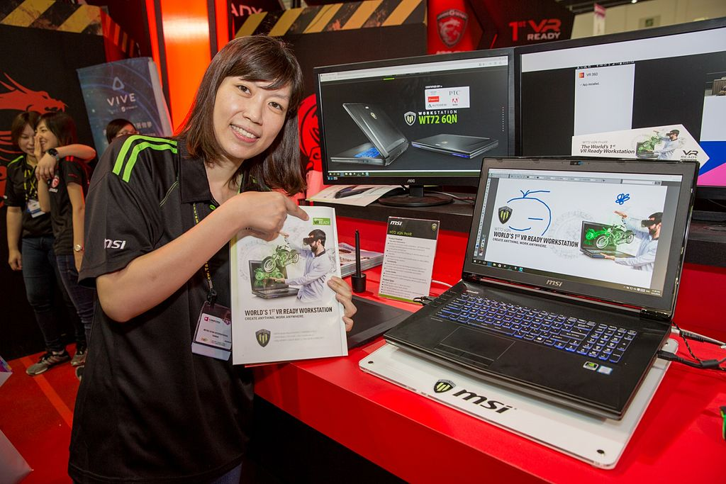 employee showing MSI Laptop
